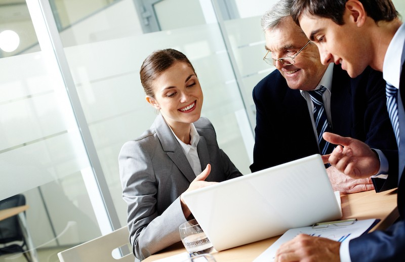 Successful,Businessteam,Of,Three,Sitting,In,Office,And,Planning,Work